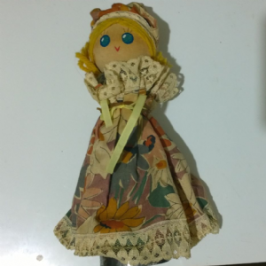 unusual handmade doll made from old wooden handle